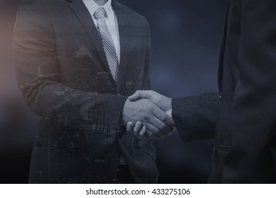 business concept,double exposure business man shaking hand