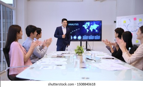 Business concepts. The young man was accepted by colleagues at the meeting.  4k Resolution.