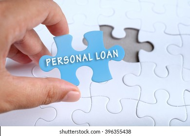 Business conceptual, hand holding puzzle written PERSONAL LOAN