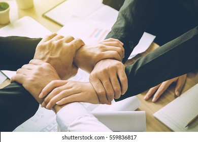 The Business Confederate hands together. The teamwork and unity is the only one completion.