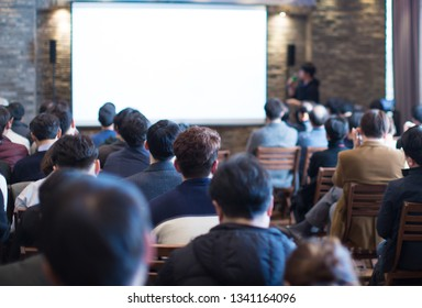 Business Conference Photo. Executive Speaker on Stage. Business Presentation Presenter Speech at Tech Entrepreneur Meeting. Corporate Event with Audience. Expert Seminar Lecture Conference Event.