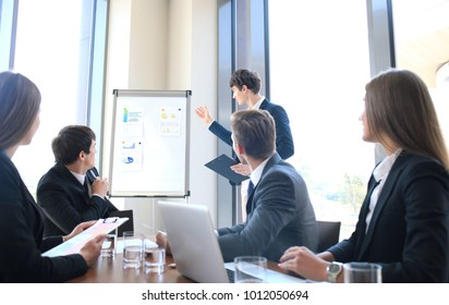 business conference presentation with team training flipchart office.
