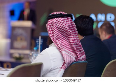 Business Conference and Presentation,Arabic businessman representing model of economic development and startup business, Audience at the big conference hall.