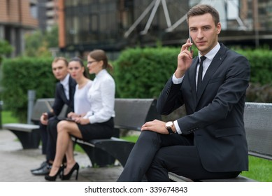 Business confidence. Business portrait of young confident and successful businessman working  on the project. Businessman at work. Business background