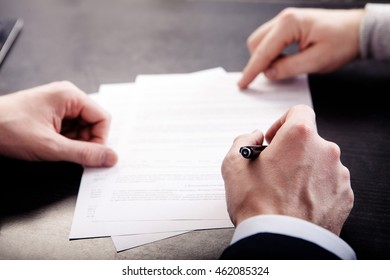 Business conflict, on business meeting manager and employee destroy draft of document.