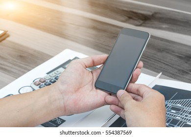business connection technology concept ,Close up of a man using smartphone with blank screen mobile ,selective focus.