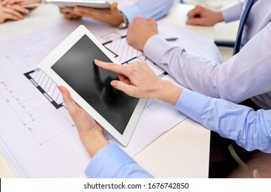 business, construction and people concept - group of architects with tablet pc computer and blueprint at office