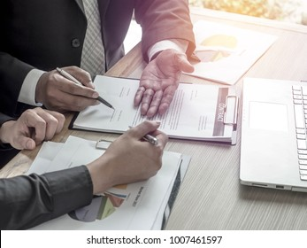 Business Contract Signing client to contract paper at desk