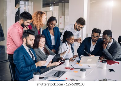 Business Corporate Management Planning Team Concept. Teamwork process.Young multiracial entrepreneurs work with new startup project in office. Nine diverse people sharing the ideas lively.