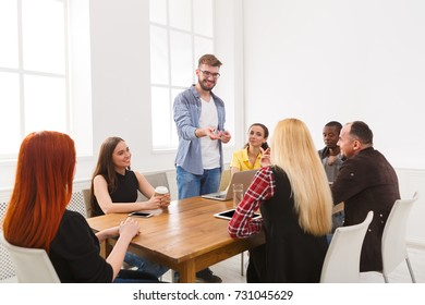 Business corporate meeting of multiethnic team. Office discussion, communication with partners, one man is making report