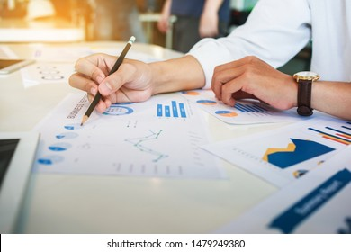 Business Corporate team brainstorming with chart and checking and analysis
