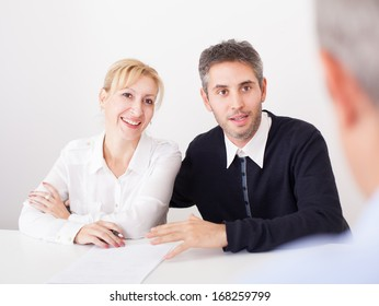 Business couple with counselor. Business couple with counselor in office.