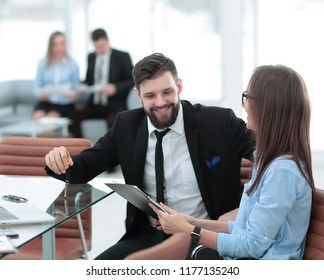 business couple discussing working paper sitting at Desk