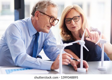 Business couple having consultations about wind energy