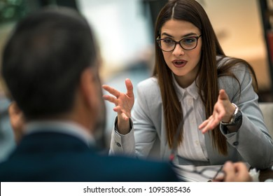 Business couple having discussion about job.