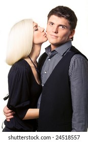 Business couple, kiss on the cheek. Isolated over white background