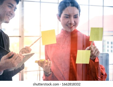 Business couple   meeting at office and use notes to share idea. Business teamwork concept.