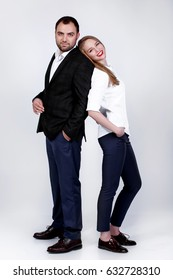 Business couple. Portrait of smiling business people isolated in studio. Stylish man and woman posing together - team work.