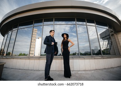 Business business couple posing against business center background. Business. Finance. Fashion.