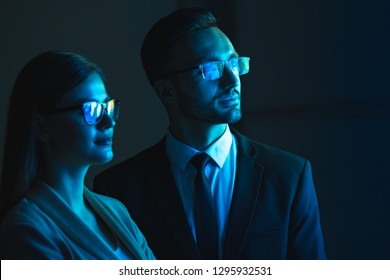 The business couple standing in the dark room