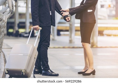 Business couple a traveler legs and suitcases in a travel location on holidays,Portrait Couple suitcase,Full length of young couple walking together on sidewalk