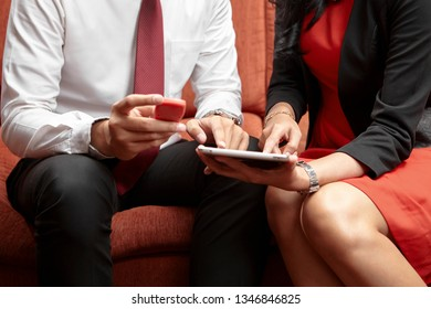 business couple using security token for e-banking with tablet