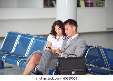 Business couple waiting at airport lounge