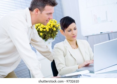 Business couple working together at office.