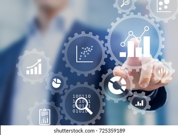 Business data analytics and robotic process automation management with a consultant touching connected gear cogs with KPI financial charts and graph, marketing dashboard