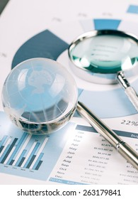 Business Data Analyzing, with magnifying glass and other on the desk.