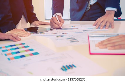 Business Data Chart and report on meeting table