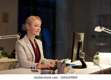business, deadline and technology concept - businesswoman with computer working at night office