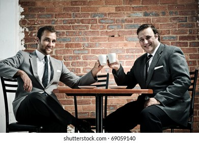 Business deal in a cafe, agreed with cappuccinos