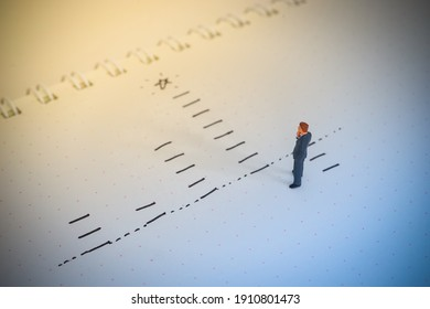 Business decision concept. Businessman thinking with promote chart