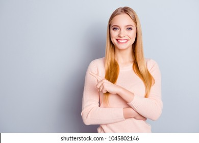 Business demonstrate forefinger sale black friday discount people concept. Portrait of cheerful excited glad smart cute pretty gorgeous manager pointing on place for text isolated on gray background