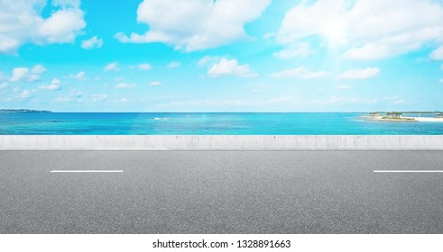 Business and design concept - empty asphalt road with panoramic sea and sky view under bright blue sky for mockup