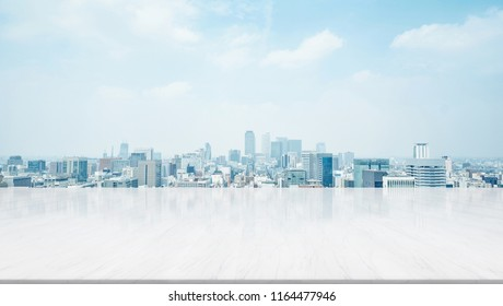 Business and design concept - empty stone panel ground with panoramic city skyline aerial view under bright sun and blue sky of Nagoya, Japan for mockup or montage product