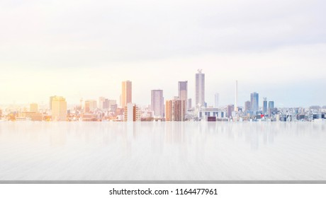 Business and design concept - empty stone panel ground with panoramic city skyline aerial view under bright sun and blue sky of Tokyo, Japan for mockup or montage product