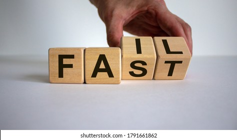Business and design concept. Man hand flips wooden cubes with words 'fail fast' on beautiful white background, copy space.