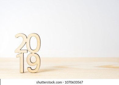 """Business and design concept - wooden word """" 2019 """" on table and white background"""