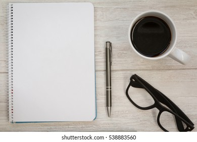 Business desktop objects on a grey wooden background