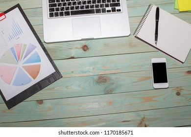 Business Desktop. Photo diagrams graphs and numerals in the table on the paper