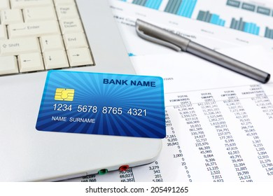 Business detail of a internet credit card,lying on top of a lap top.