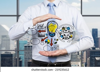 Business development concept, light bulb as a symbol of the new idea and different stages of business development. Businessman holding a flowchart.. ,