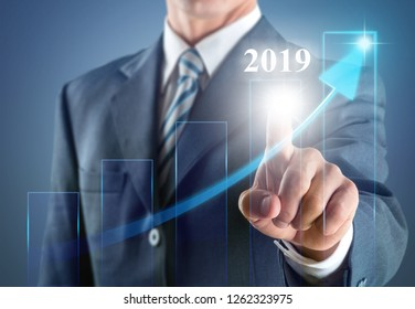 Business development to success in 2019 concept. Businessman pointing arrow graph corporate future growth plan