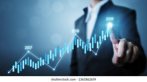 Business development to success and growing growth year 2019 concept, Businessman pointing line dot graph corporate future growth plan