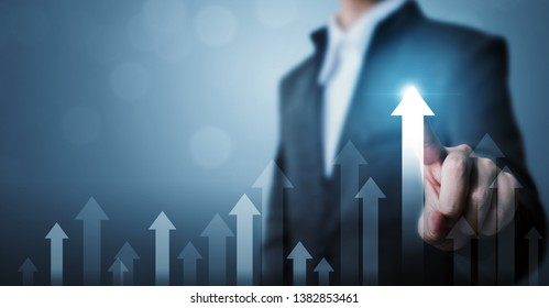 Business development to success and growing growth concept. Businessman pointing arrow graph corporate future growth plan