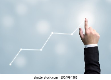 Business development to success and growing growth concept. Hand of businessman pointing arrow graph corporate future growth plan
