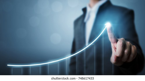 Business development to success and growing growth concept, Businessman pointing arrow graph corporate future growth plan - Shutterstock ID 748617433