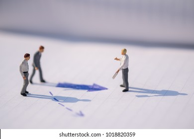 Business Direction concept. Group of businessman miniature figures standing, walking and standing on notebook with arrow signs under sunlight